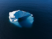 Drone point of view majestic iceberg on blue