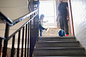 Father and toddler son playing with soccer ball