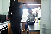 Father and toddler son in apartment kitchen