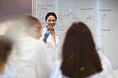 Female science teacher leading lesson in classroom