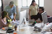 Designers working in open plan office