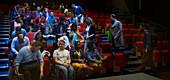Audience arriving in auditorium