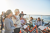 Friend tourists with bicycles eating ice cream
