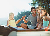 Smiling family in rowboat