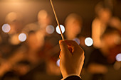 Close up of orchestra conductor holding baton