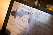 Reflection of violin on sheet music