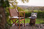 Colleagues video chatting on laptop screen on rural balcony