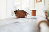 Bread dough proofing in basket on kitchen counter