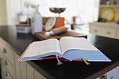 Cookbook open on kitchen counter