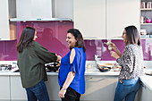 Happy Indian women cooking food in kitchen