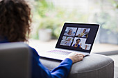 Senior women friends video conferencing on laptop screen