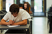 Focused boy student taking exam
