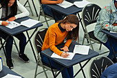 Focused girl student taking exam