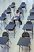 Dedicated boy student taking exam