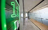 Neon sign in modern business office corridor