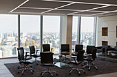 Chairs in circle in modern urban highrise office
