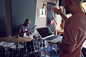 Musicians with drums and laptop