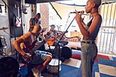 Musicians practicing in garage recording studio