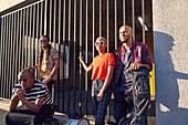 Portrait musicians outside sunny parking garage