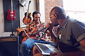 Male musicians practicing in recording studio