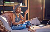 Female singer song writing in recording studio