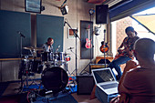 Musicians practicing in music recording studio