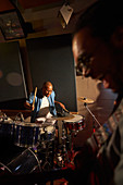 Male musician playing drums in recording studio