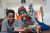 Happy brothers getting new sneakers for Christmas