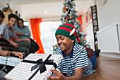 Happy boy opening Christmas gift