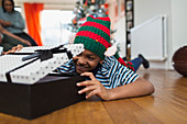 Excited boy opening Christmas gift