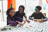Happy mother and kids making Christmas cookies