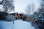 Snowy home showcase exterior and driveway