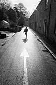 Boy running on road
