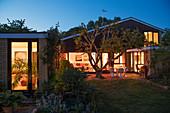 Illuminated home showcase exterior at night