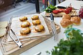 Cheeseburgers on cooling rack