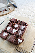 Powdered sugar hearts on brownies on cooling rack