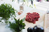 Raw ground beef and herbs