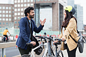 Business people with bicycles talking