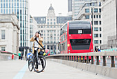 Businesswoman and bicycle, London, UK