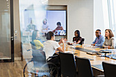 Business people talking and video conferencing