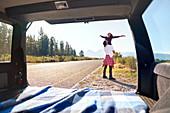 Carefree couple outside car at remote roadside