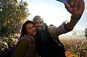 Happy young couple taking selfie on hike