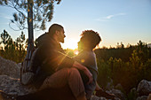 Couple enjoying tranquil sunset in woods