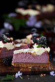 A slice of blackberry cheesecake