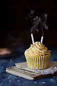 Cupcake with smoking candles