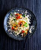 Cauliflower rice with gratinated chicken medallions