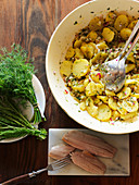 Potato salad with herring and dill