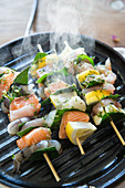 Steaming fish skewers in a grill pan