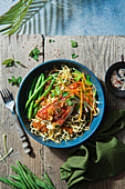 Oriental noodles with chilli jam, beans, herbs and grilled red snapper