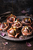 Figs baked with prosciutto, gorgonzola and maple syrup